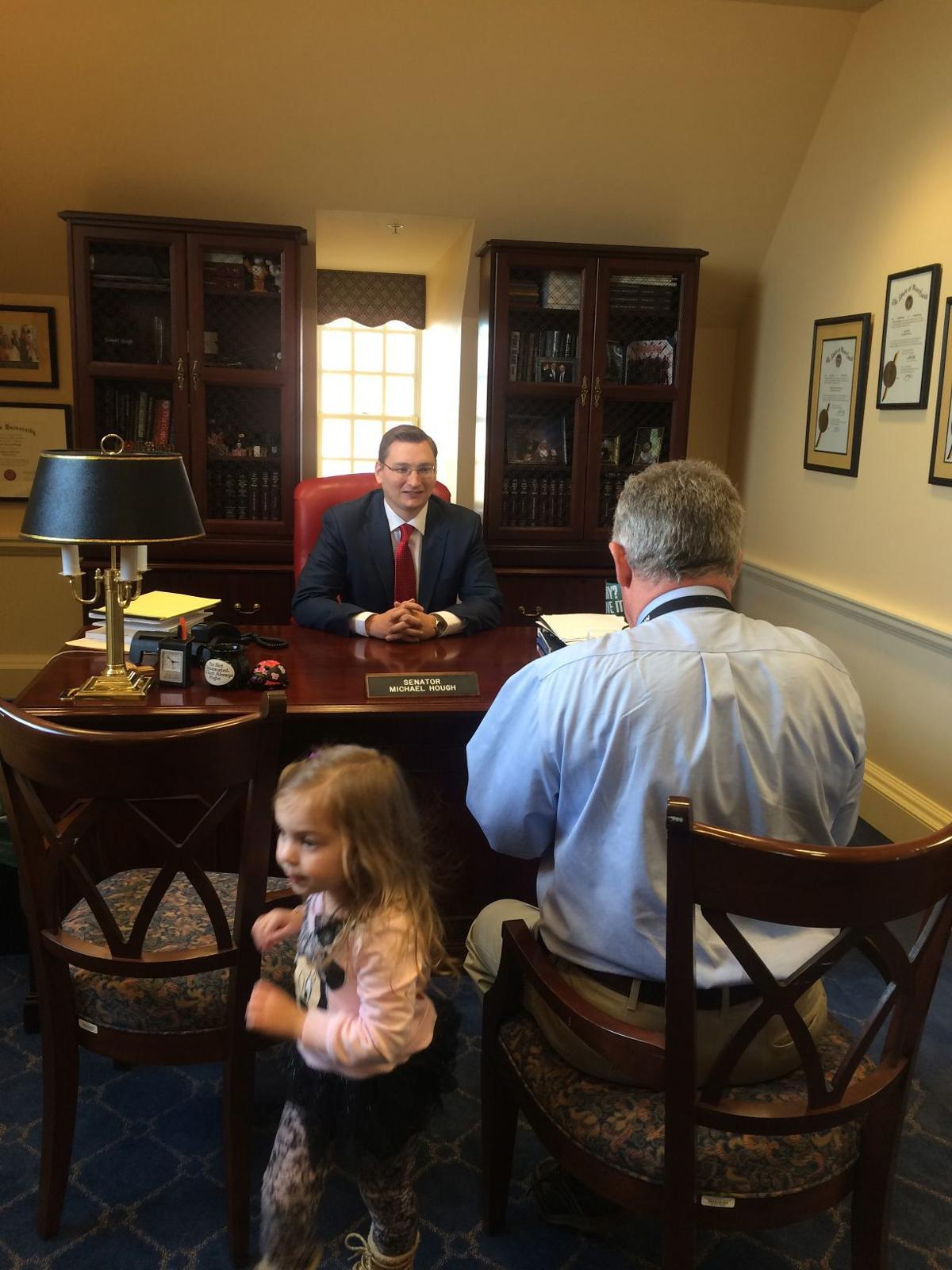 Senator Hough sits for portrait as daughter looks on