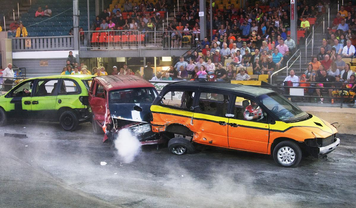 Demolition derby at the fair with minivans