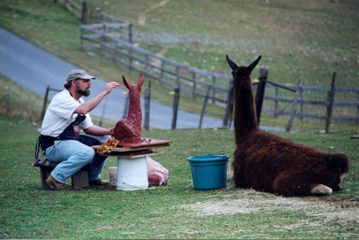 Artist, Homer Yost, Sculpting llama, Viking. (Photo by Phill Grout