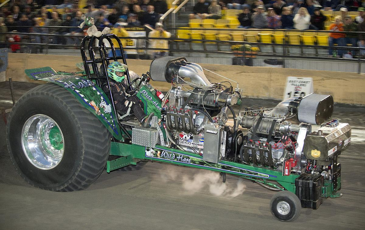 At The Great Frederick Fair: Mean, green, tugging machines compete in the tractor pull. More photos, page A6. Fair coverage, page B1.
