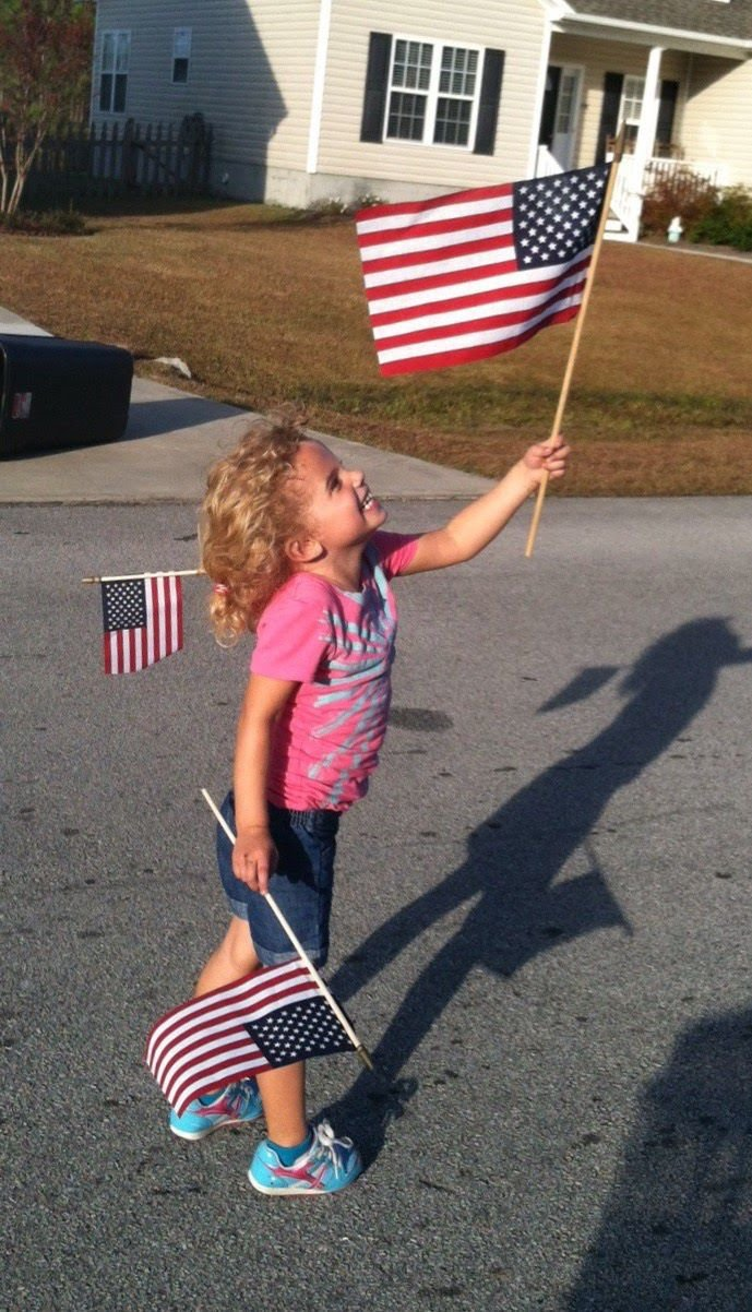 Girl and flags.JPG