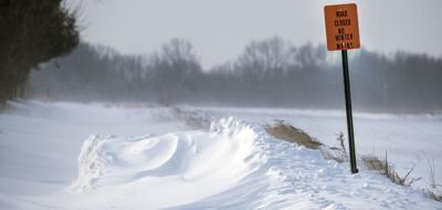 High winds, drifting snow
