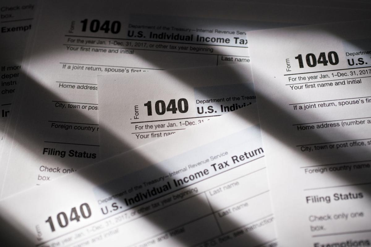 Irs gives taxpayers an extra day to file after computer crash us department of the treasury internal revenue service irs 1040 individual income tax forms for the 2017 tax year are arranged for a photograph in falaconquin