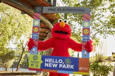Walkaround Elmo from Sesame Street visits the PNC Playground at Promenade Park