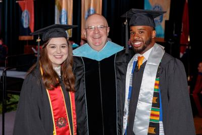 Dalis Lampkins (left), of Gleason, and Ashton Sawyers (right), of Gallatin, received Paul and Martha Meek Leadership Awards during the University of Tennessee at Martin's spring 2019 commencement exercises May 4. They are pictured with Dr. Andy Lewter, UT Martin vice chancellor for student affairs. SUBMITTED