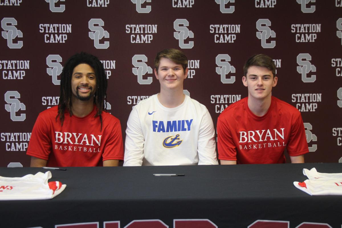 Kavon Blakenship, Cameron Gerlach, and Eli Thurston sign scholarship papers Tuesday afternoon at Station Camp High School.