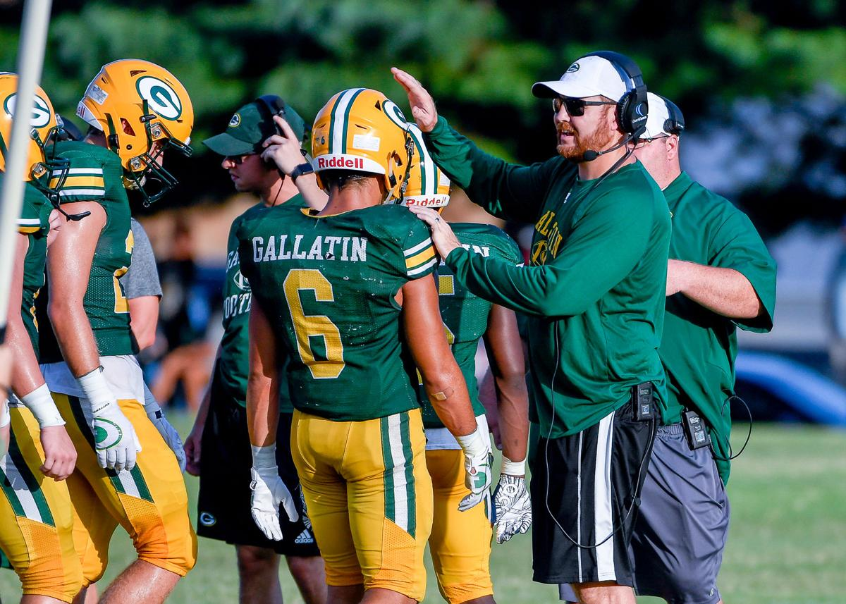 Head coach Chad Watson gives encouragment to running back Spencer Briggs.