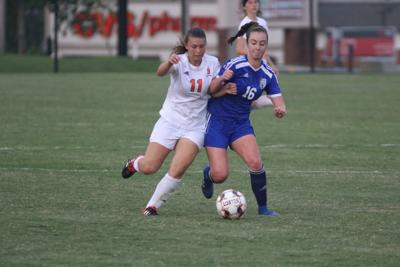 Carlee Zettergren (16) and Hailey Burroughs (11) battle for possession.