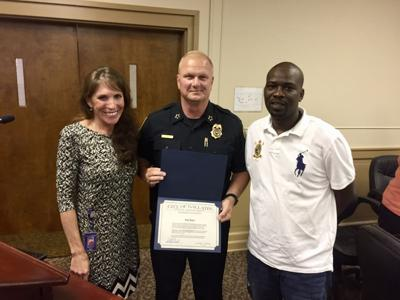 Gallatin resident Randy Rogers was recognized by Police Chief Don Bandy and Mayor Paige Brown last week for rescuing the driver of a burning vehicle on April 20. SUBMITTED