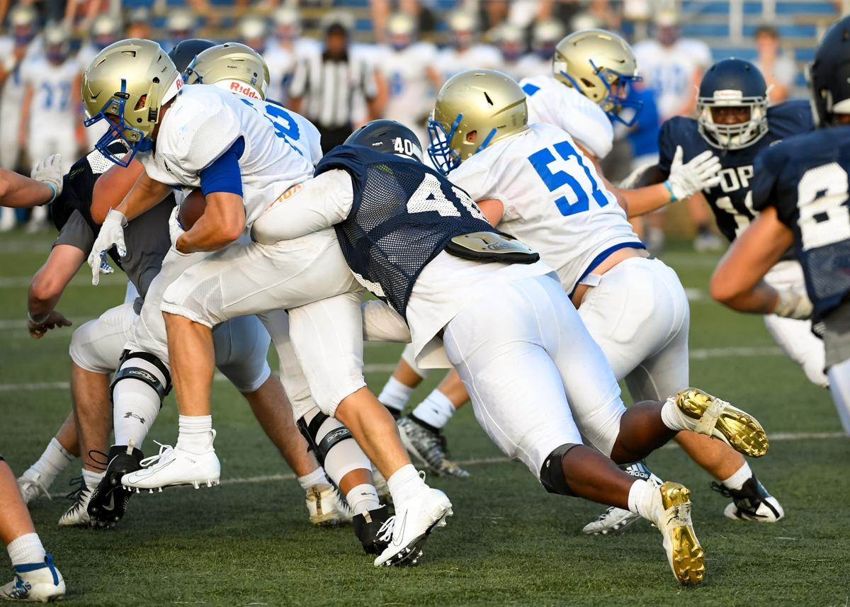 Jay Wright brings down a Brentwood ball carrier on the Knights scrimmage Friday night.