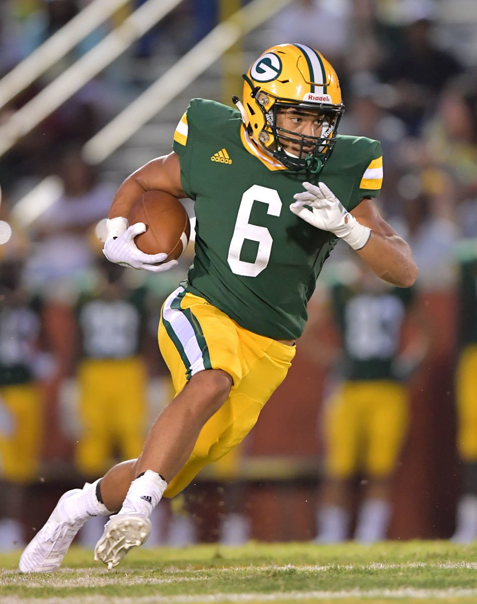 Spencer Briggs carries the football during a Green Wave game in 2019.