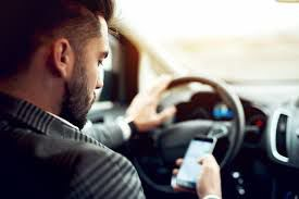 Cellphone driving - FILE PHOTO-ONLINE ONLY