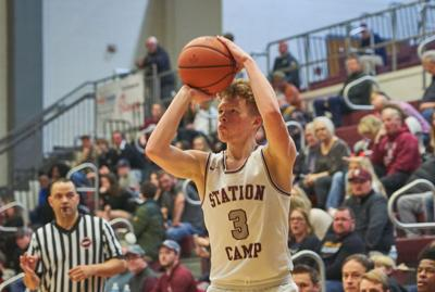 Station Camp's Trey Moore makes a three-point shot Friday night against Wilson Central.