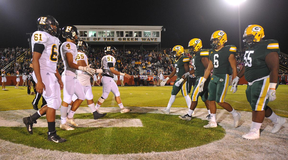 Captains shake hands before the coin toss Friday night on Calvin Short Field..jpg