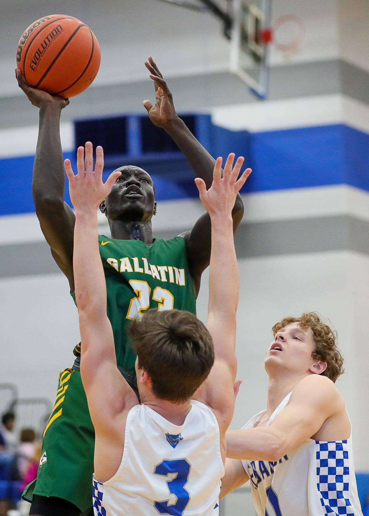 Beljwok Adaing attacks the basket for Gallatin.