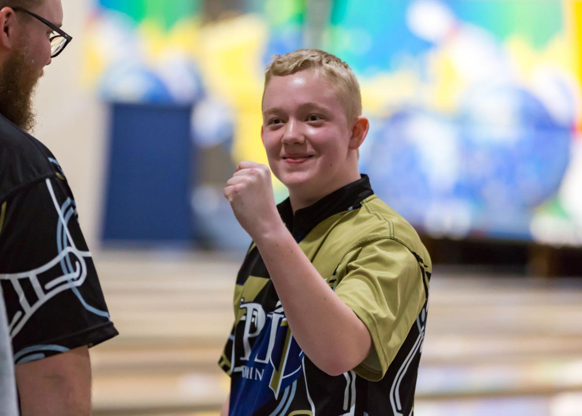 Matthew Mesecher pumps his fist after winning the 2020 state bowling championship.