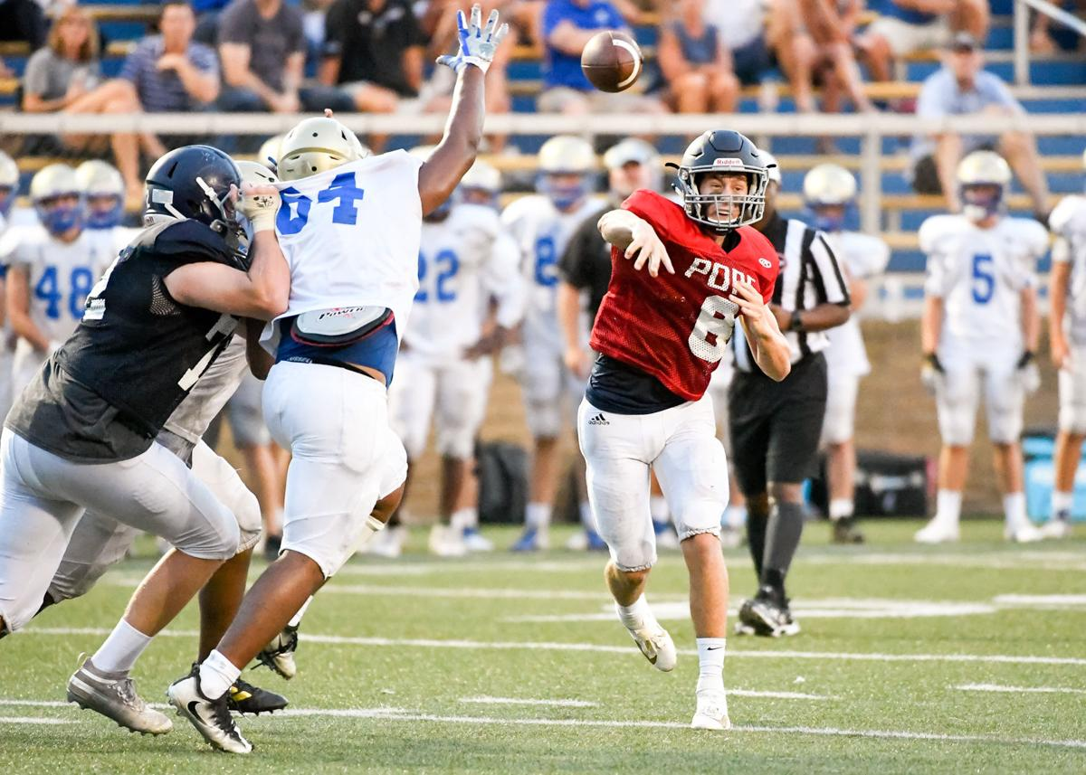 Sawyer Watts throws a pass to one of his receivers Friday night.