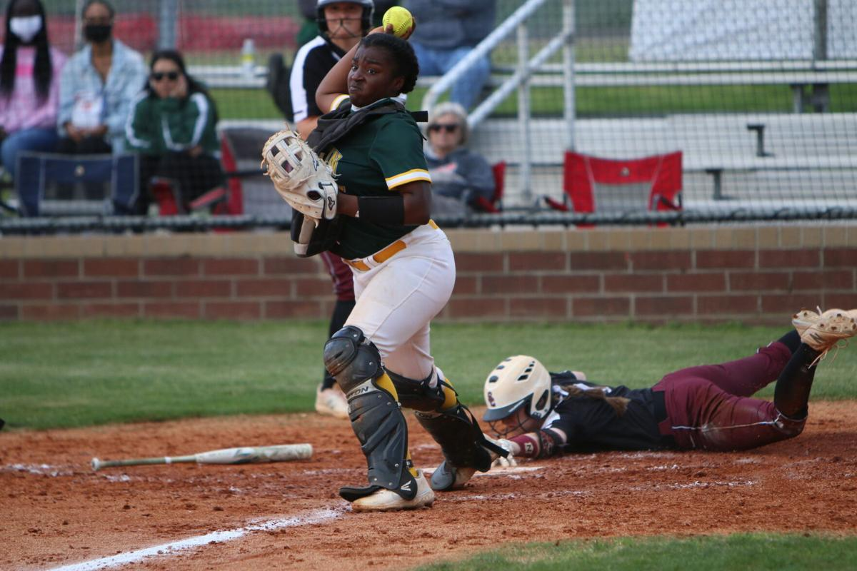 A'Niya Boone throws to third base after Lily Jarvis scores a run..JPG