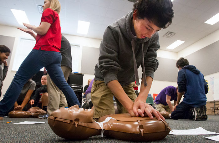 ... Corrales practices Hands-Only CPR during a lesson by officials from the  American Heart Association at the school in Galveston Friday, April 17, 2015 .