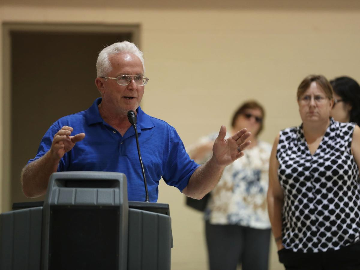 Flood victims get few answers at town hall meetings
