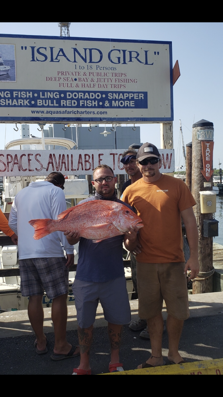 Capt. Cody Kenney with red snapper.png