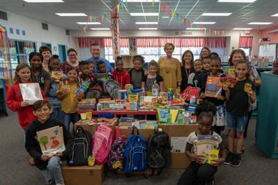 COMPeers donate supplies to Hitchcock schools