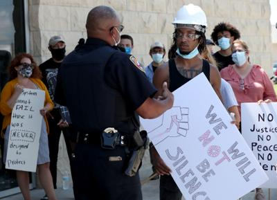 Protestors gather at law enforcement center in Galveston