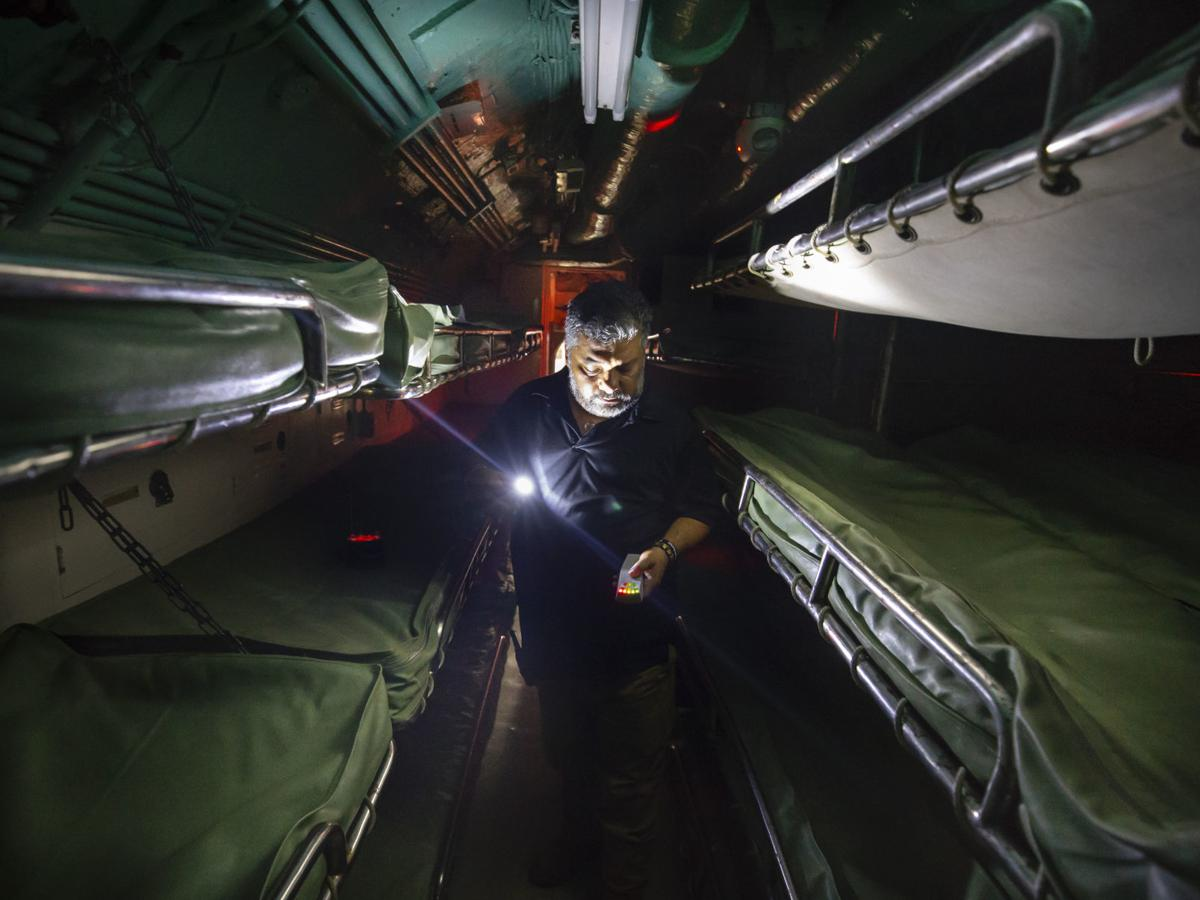 After dark, ghost hunters search the USS Cavalla