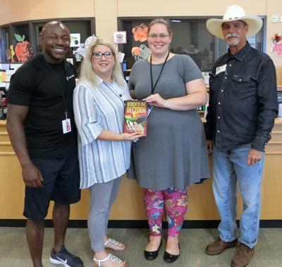 Texas City ISD library receives signed copy of book