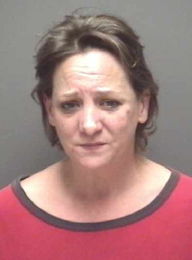 Woman charged with murder in husband's shooting death