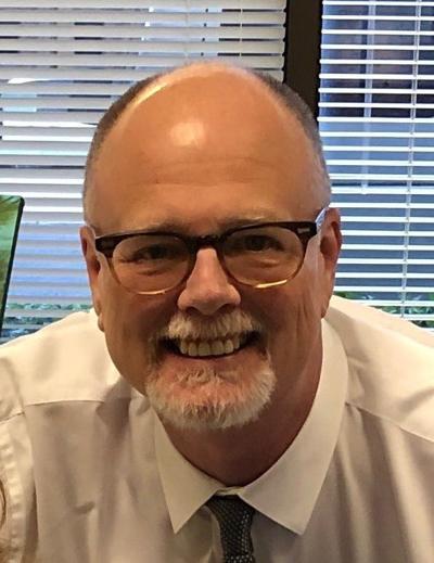 Mark L. White