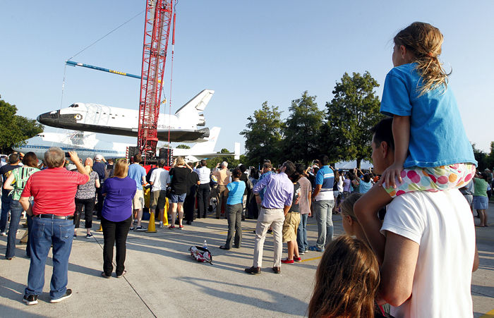 Shuttle replica hoisted to new home