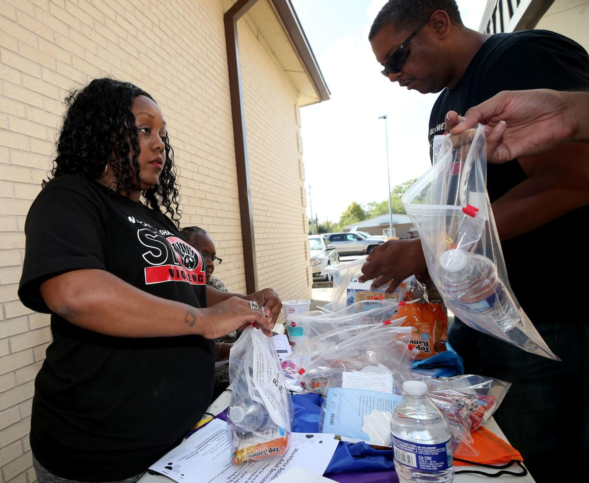 Stop the Violence 409 volunteers hit the streets in outreach event
