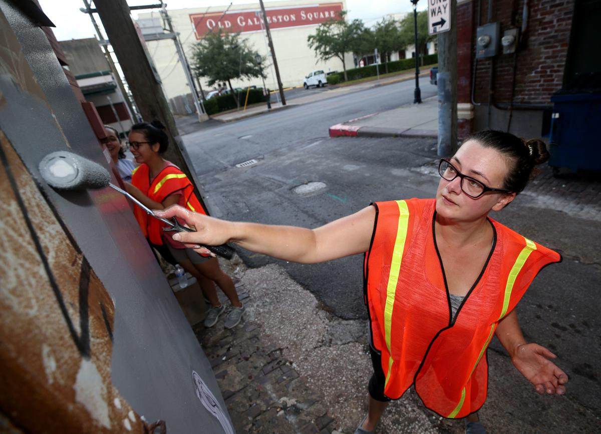 Business owners, volunteers join Galveston police in graffiti clean up