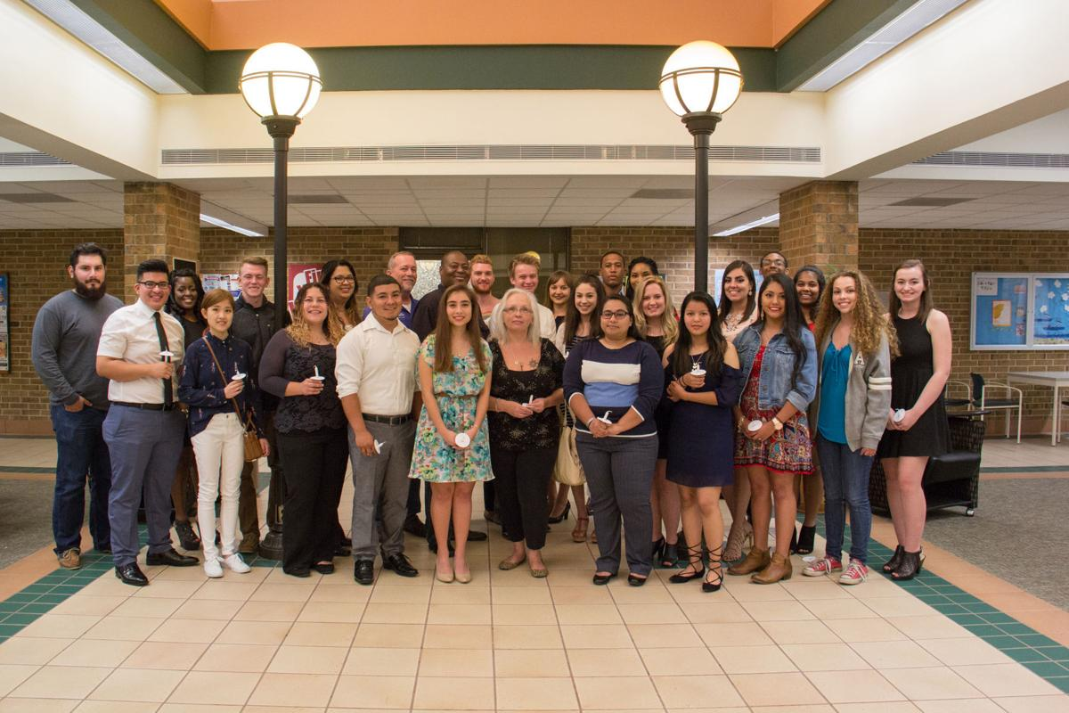 COM inducts honor students