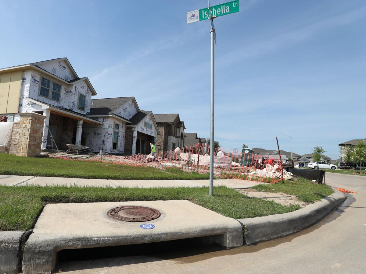 Officials: Build homes higher, lower water in streets