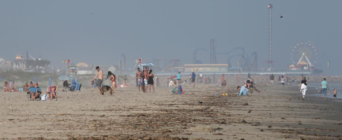 Warm, sunny weather draws people to beaches
