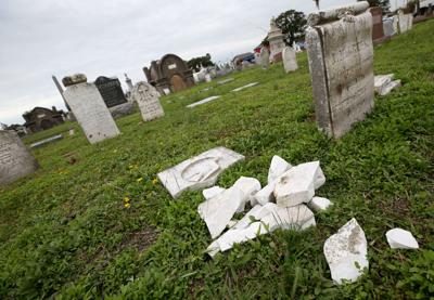 Headstones damaged in historic cemetery