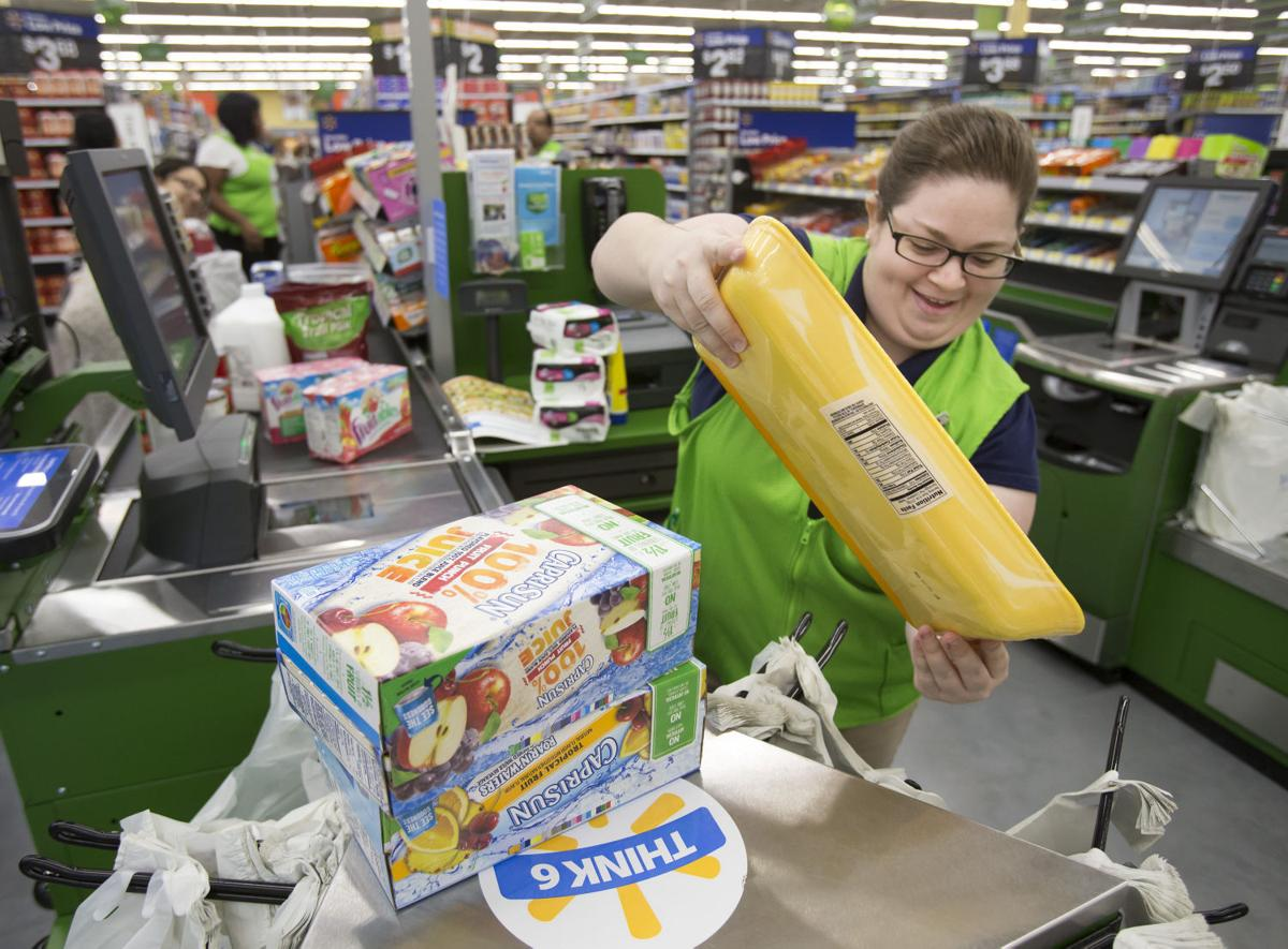 wal mart neighborhood market employee krystal janysek bags up groceries in the league city store that opened in january