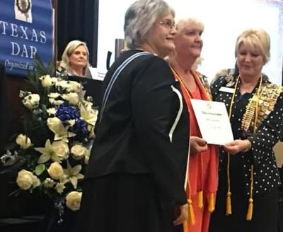Donna Hatch receives cord, certificate from DAR