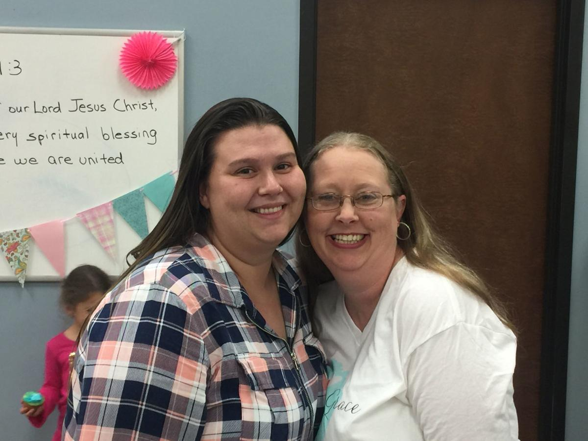 Amber Cole Myself and alumni Brenna Webb at a baby shower. She attended to support the next semester of moms..JPG