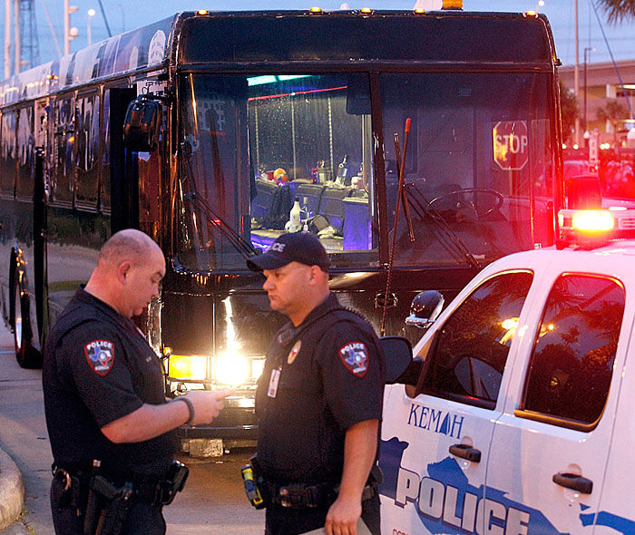 Police charge 2 adults, 1 teen in prom party bus incident