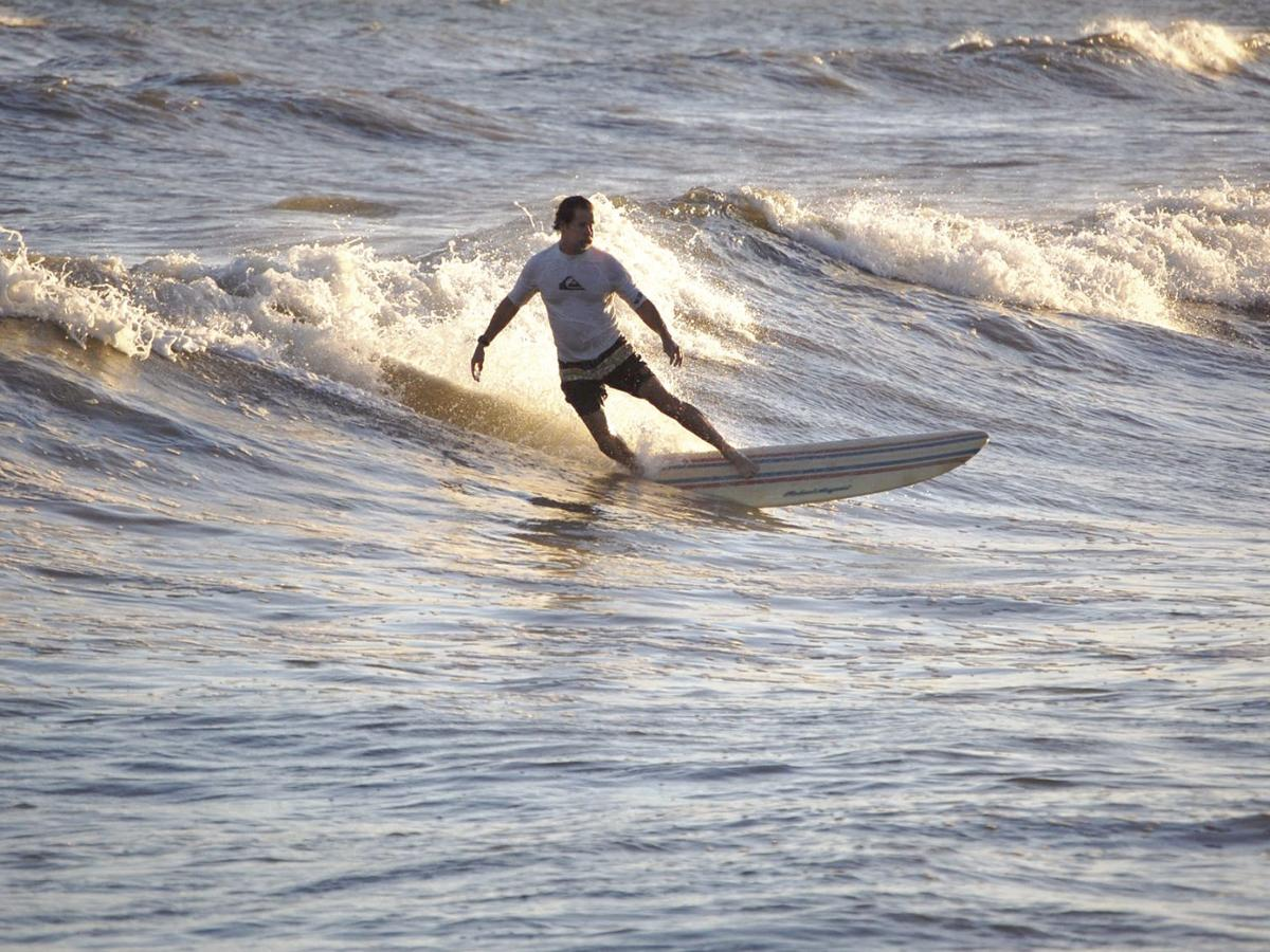 Despite crowds, surfing is truly a solitary endeavor