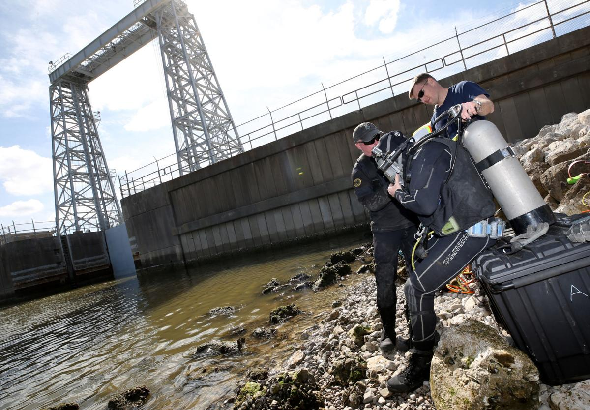 U.S. Army Corps of Engineers divers check floodgate