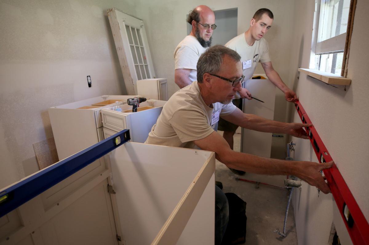 Volunteer groups help Harvey victims during spring break