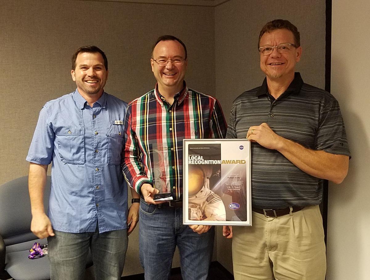 Damon Smith presented with award