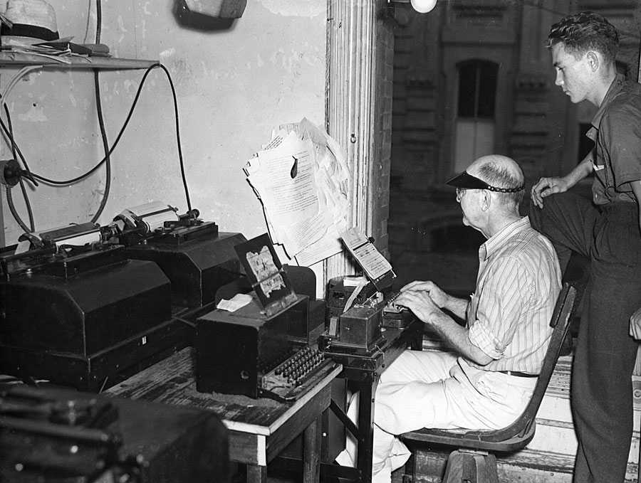 Daily News employees work in the teletype room at the old offices on Mechanic Street.