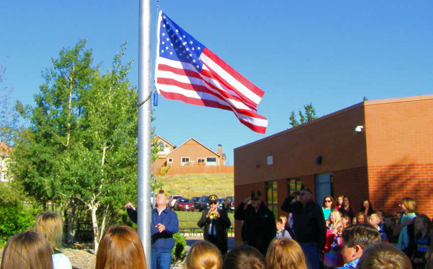 Broad stripes, bright stars: Woodland Park students learn symbolism of star spangled banner