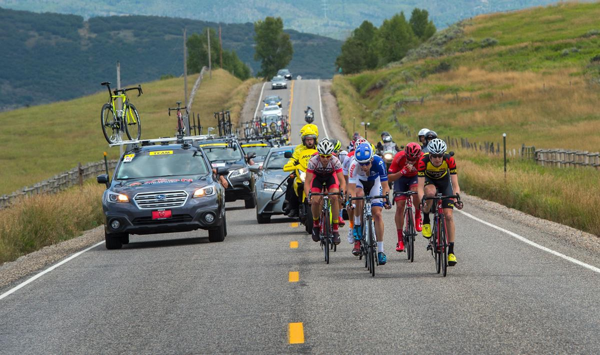 Riders race along Highway 33 toward Oak Creek Monday, Aug. 17, 2015, during Stage 1 of the 2015 USA Pro Challenge in Steamboat Springs, Colo. Stage 1 is a two-lap, 97 miles circuit beginning and ending in Steamboat Springs. (The Gazette, Christian Murdock)
