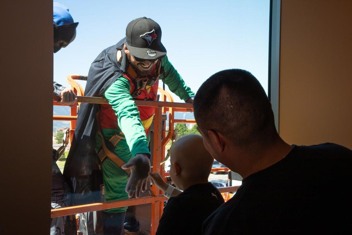 Superhero Squeegee Squad brings smiles to Children's Hospital Colorado
